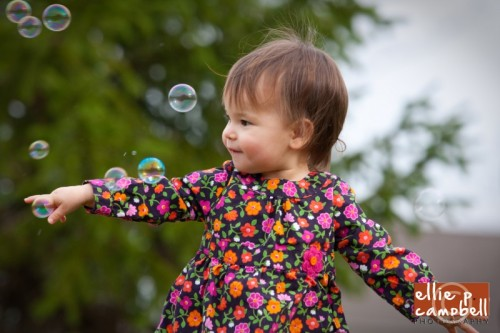 Lily playing with bubbles